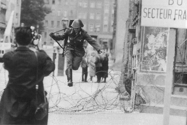 GDR soldier Conrad Schumann escapes to West Berlin, 15 August 1961.