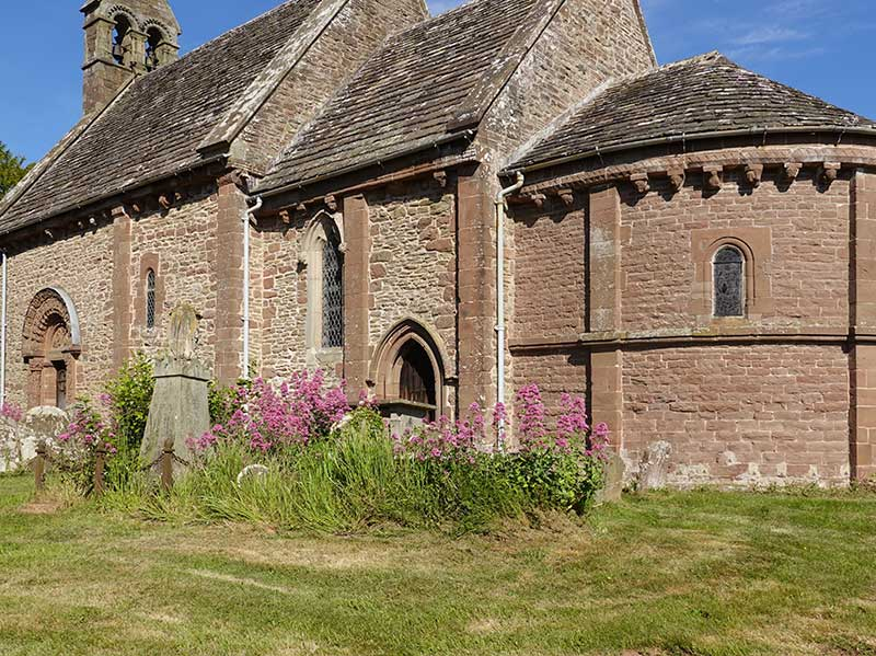 The parish church at Kilpeck in Herefordshire, with John McNeill